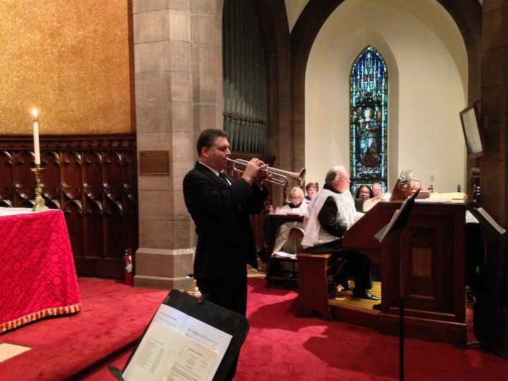 Trumpet player Jim Paradies announces the bride's arrival