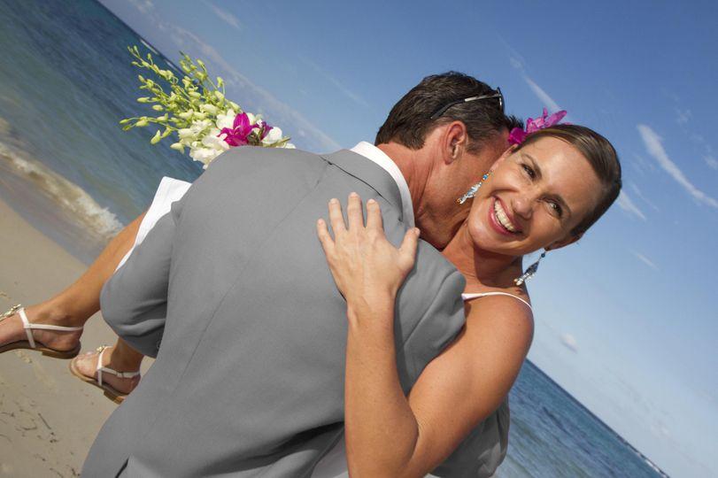 playful beach bride and groom84862