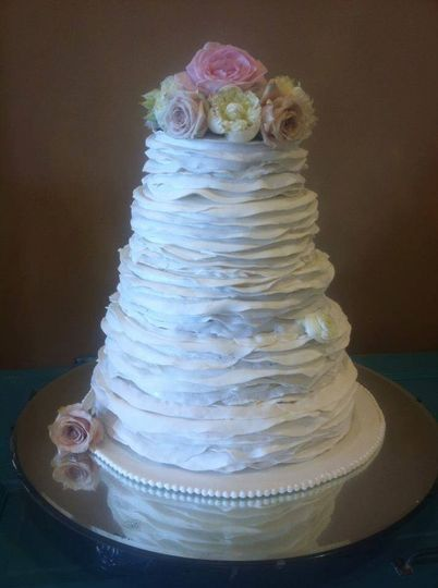 5-tier wedding cake with flowers