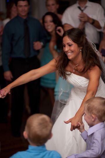 Bride dancing with kids
