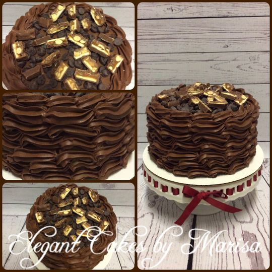 Birthday cake topped with Snickers candy