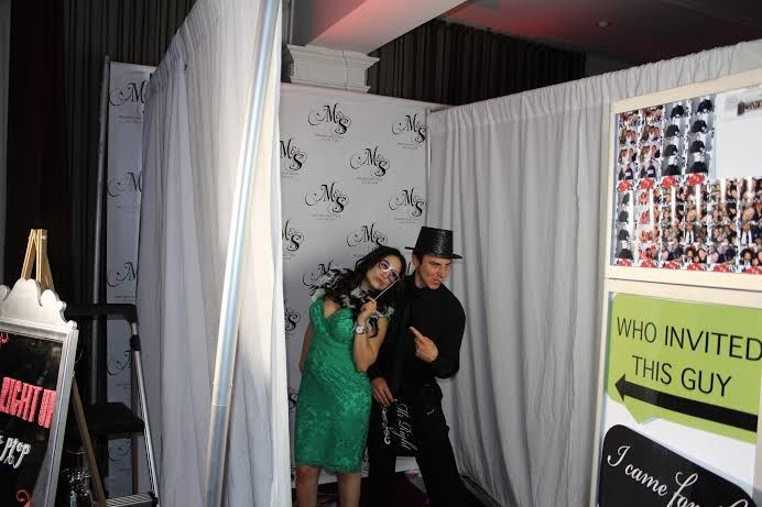 couple in pipe and drape booth