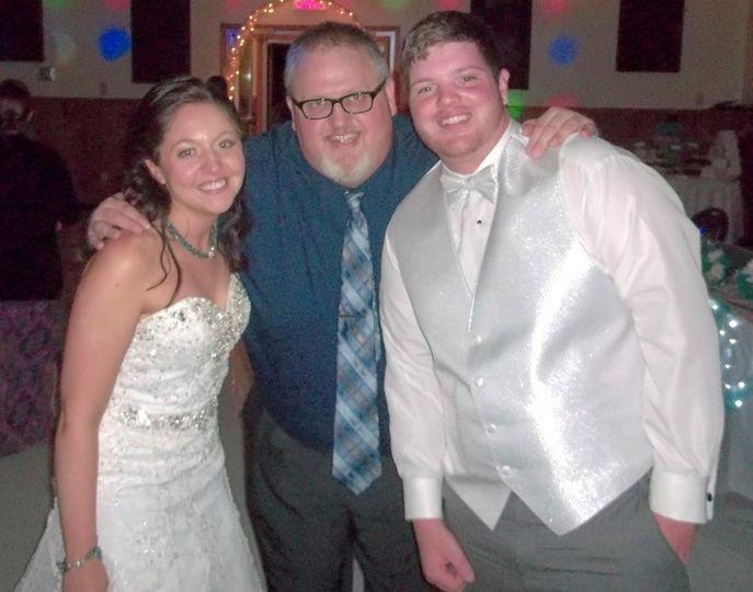 Couple with the wedding DJ