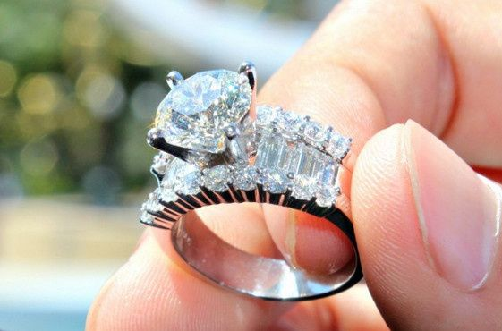 Crystal ring with diamond on top