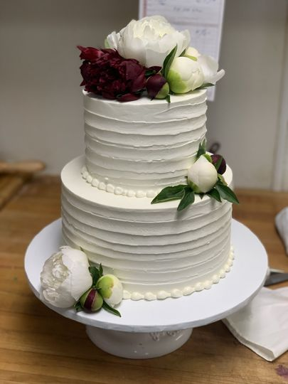Dented cake with pearl piping
