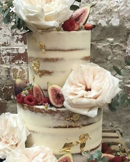 Naked cake with gold-leaf and fruit