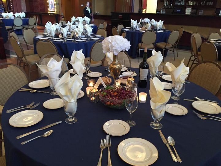 Table setup with white flower centerpiece