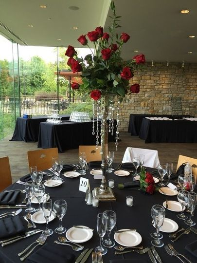 Round table setup with rose centerpiece