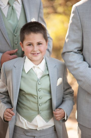 The youngest groomsmen strutting his stuff