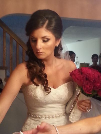 Bride with her red bouquet