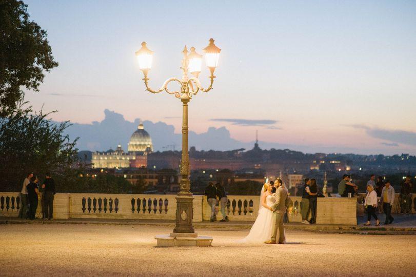Bride and groom under a watercolor sky