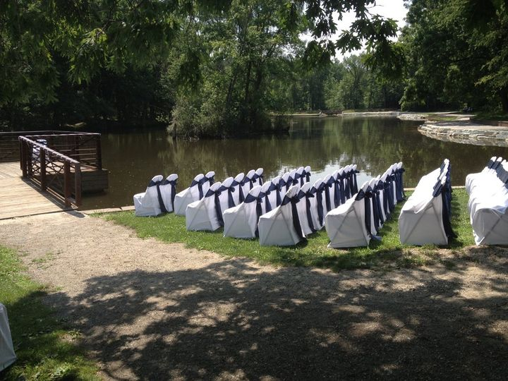 Outdoor Wedding Ceremony Folding Chair Covers with Navy Blue Sash www.NewChairDo.com