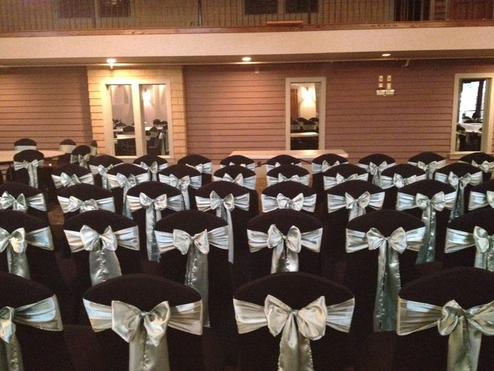 Sage Sash Bow Tie on Black Spandex Chair Cover at Courtyard at the Docks Toledo, OH...