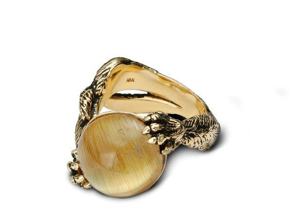 A fun piece that shows a kitty kat at play. The golden quartz resembles a cat's eye and also a yarn...