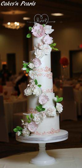 White roses ascending baby pink cake