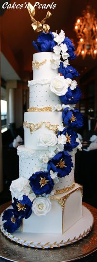Royal blue flowers ascending five tier angular cake