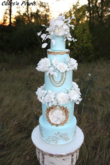 Elegant baby blue cake with white flower decorations