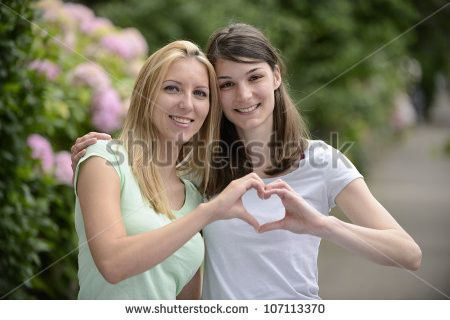 stock photo lesbian couple forming heart shape wit