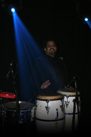 Percussionist Eddie Torres of Naked Soul. Photo by Christopher Anthony Studios.