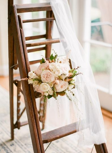 Bridal bouquet on the ladder