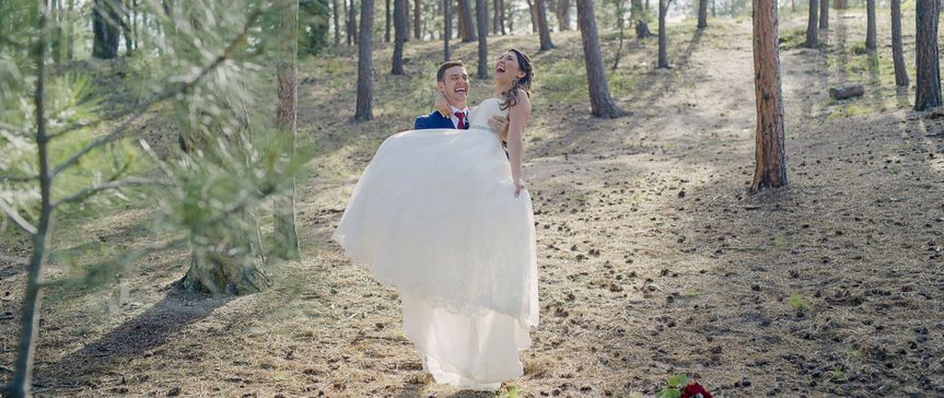 Bride and groom in a Colorado forest