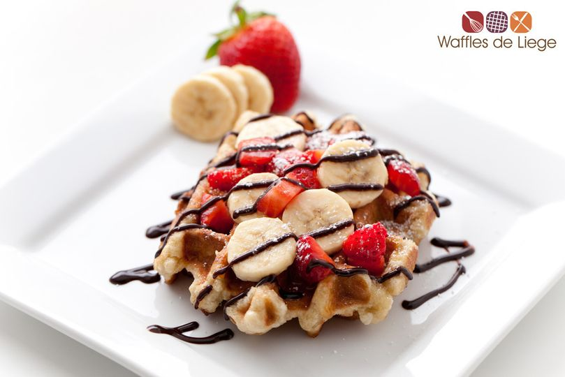 Our Fresh Fruit Waffle features our signature Liege waffle with fresh strawberries, bananas, and...