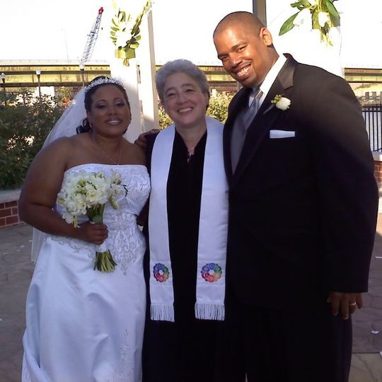 Bride, groom, and the officiant