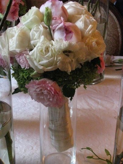 October wedding with garden roses rannunculus and lisianthus hand wrapped