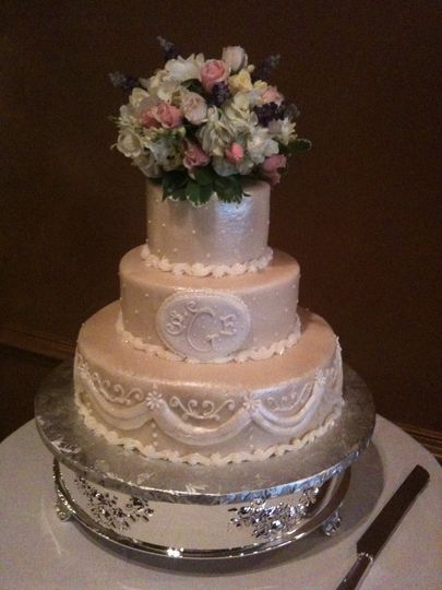 Elegant beige cake with white pumpings