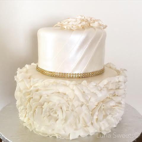 ruffles rosettes wedding cake