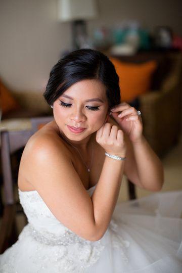Bride wearing her earing