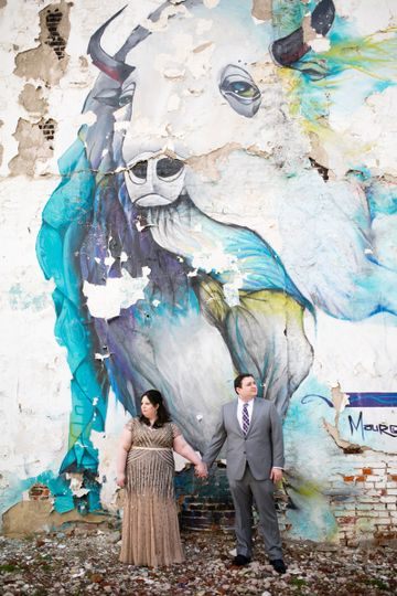 Couple photo in front of street art