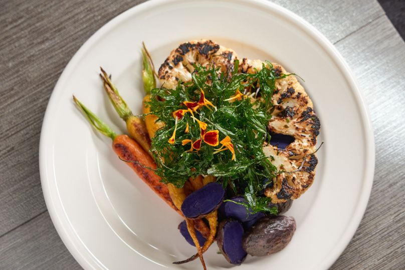 We are happy to accommodate your vegan guests.  Entree: cauliflower steak