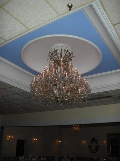 Our Large Crystal Chandelier overour Beautiful Marble Dance Floor