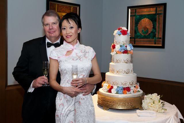 Newlyweds and their wedding cake