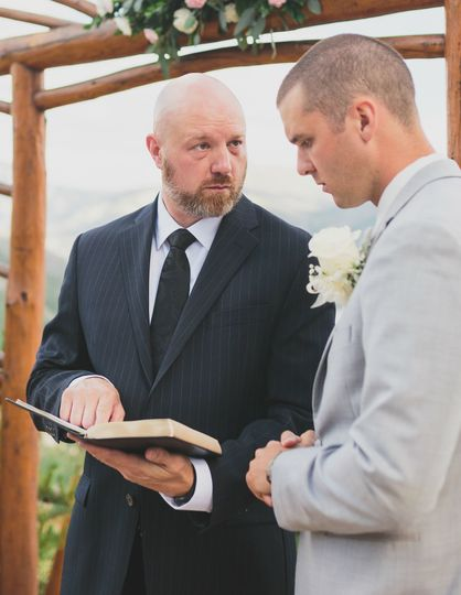 Last minute wedding ceremony notes. Photo by Kelly Costello Photography.