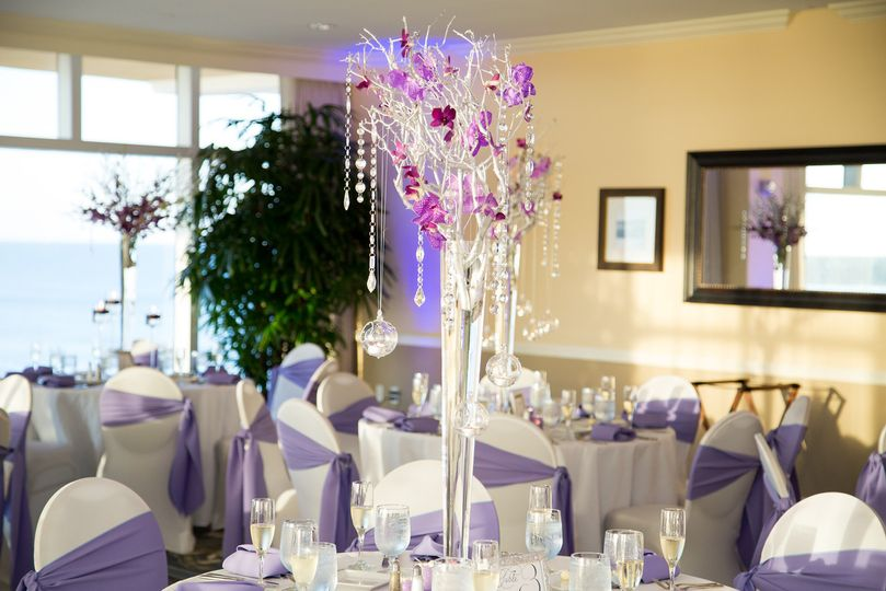Purple chair bands and raised floral centerpiece