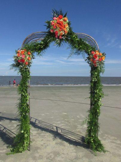 Jekyll Island wrought iron arch ocean wedding