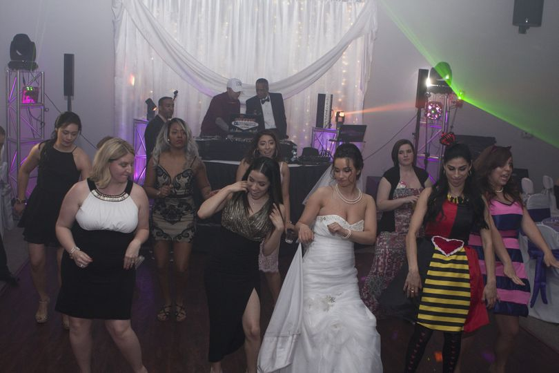The bride dancing with friends