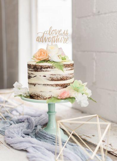 Naked wedding cake and table decor