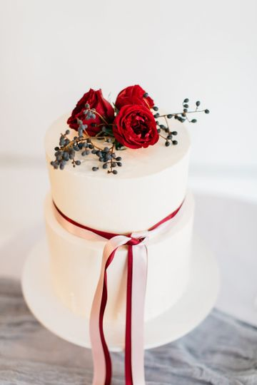 Wedding cake with red and white ribbon