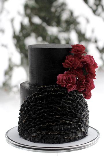 Black, ruffled cake