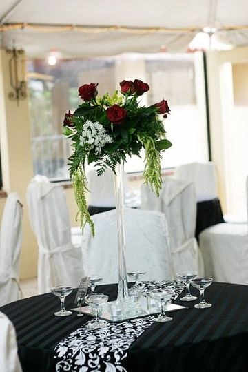Hope Wedding Centerpiece: Black Magic roses, Green Cybidium Orchids, Queen Anne's Lace, Green...