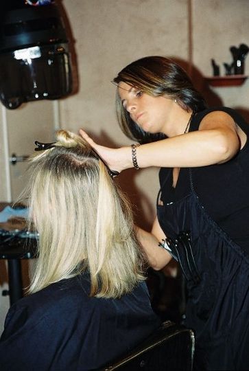 Cassandra Roberts is a lead stylist trained at the Paul Mitchell School.