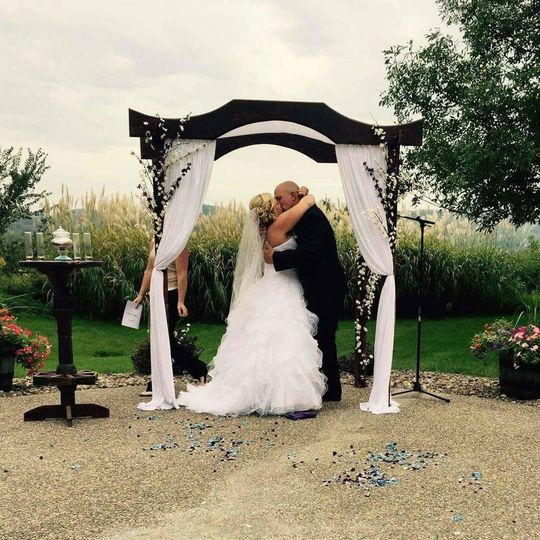 Kiss under wedding cabana