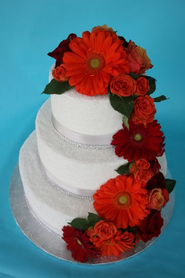 Red flowers cascading the cake