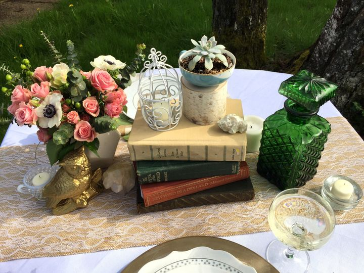 Books with candle and flower centerpiece