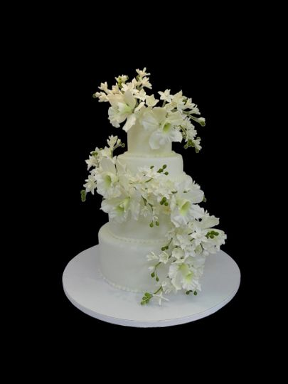 Three tier white cake with white flowers