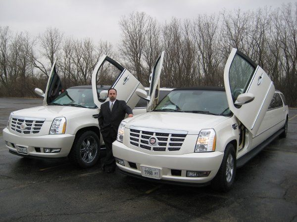 Company owner, Michael Colella, with his new fleet of superstretch Escalades