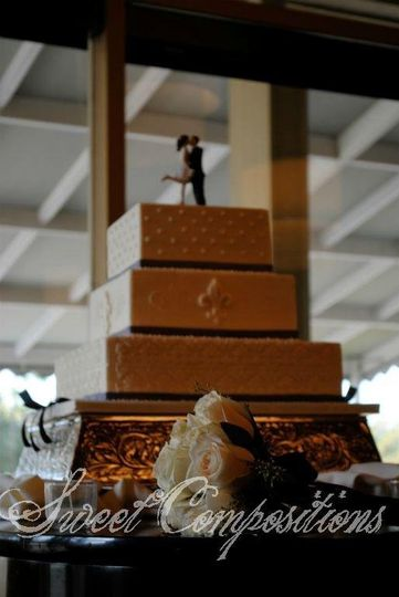 Who says wedding cakes have to be white? This gold and brown beauty makes an opulent display.